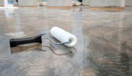 Mangelhaftigkeit eines Fußbodenbelags in Ladenlokal - Knackgeräusche / Auswölbung